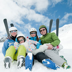 family of skiers at a ski resort