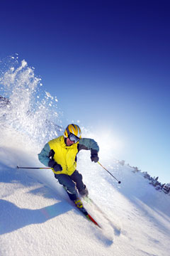 skier skiing on a mountain ski slope